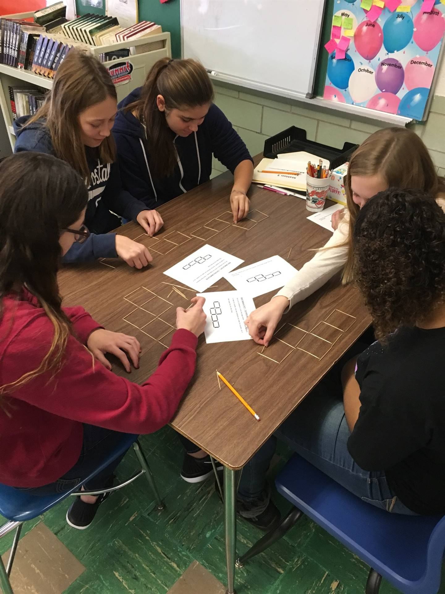 Students are working on a logic problem manipulative in Mrs. Fabish-Rupert and Mrs. Zetts' classes.