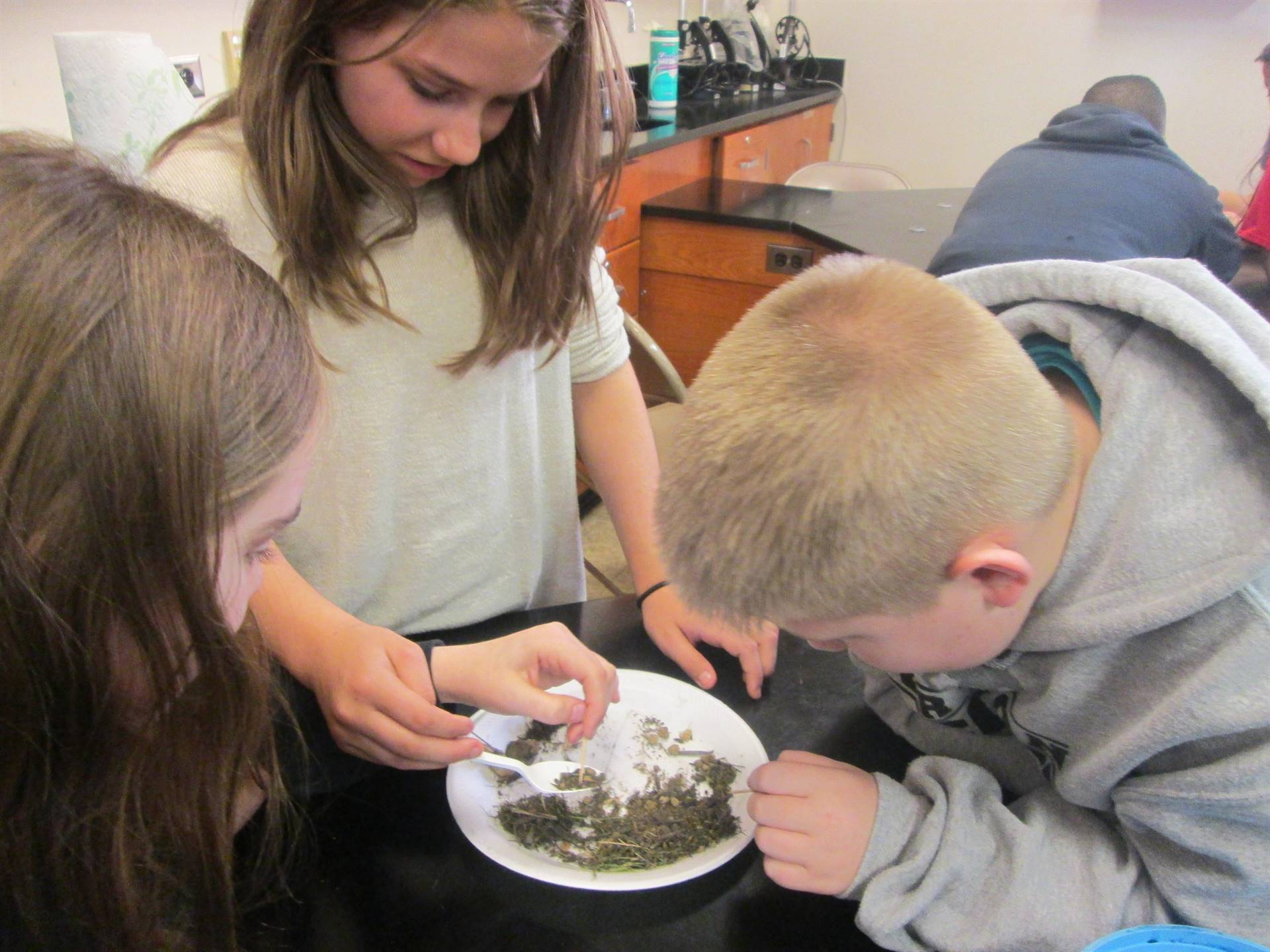 Students from Mrs. Berlin's 6th Grade Class Studying Soil