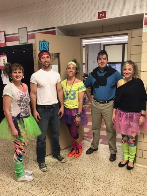8th Grade teachers celebrate Decades Day with a throwback to the '80s.