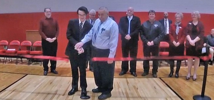 cutting the ribbon for high school in gym