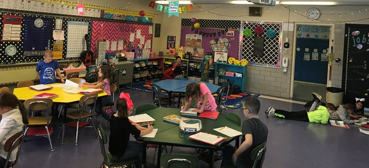 Students in Mrs. Myers' second grade classroom work together to practice language arts skills during center time.