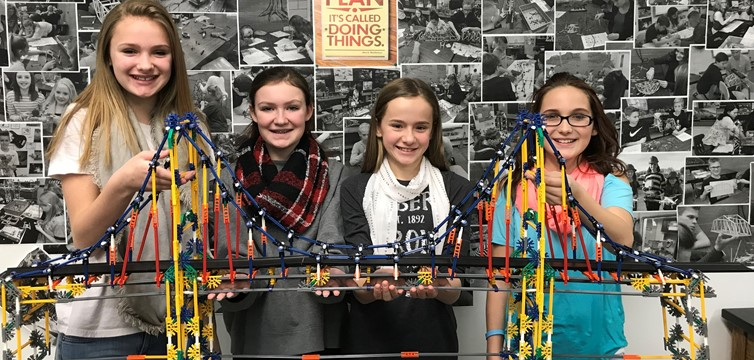 Students follow assembly drawings to complete their K'NEX Bridge Project in Mr. Aurand's S.T.E.M. class.