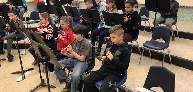Here are our 4th graders playing their recorders in music class with Mrs. Williams.