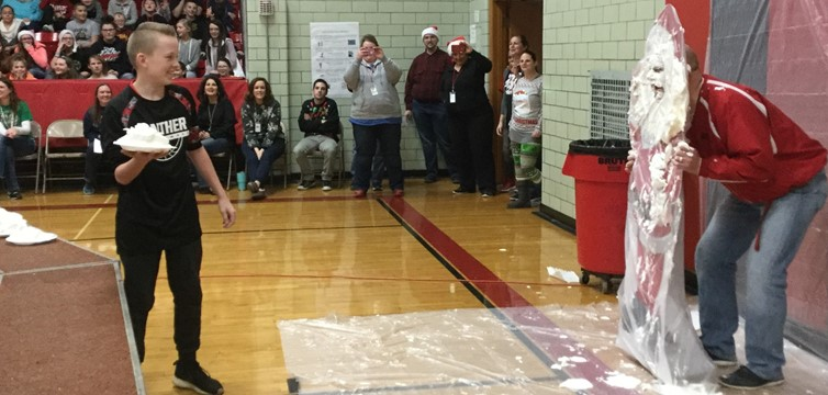 Student winners from our Norton Aid campaign hit Mr. Dobbins in the face with a pie.
