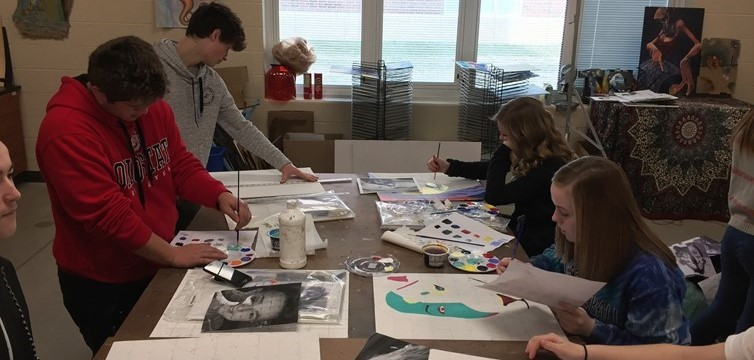 Students in Ms. Thornberry's Drawing & Painting 1 class working hard on their Fauvist Spirit Animal projects