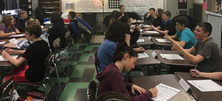 Students in Mrs. Bruce's language arts classroom are practicing the art of persuasion with some speed debating!