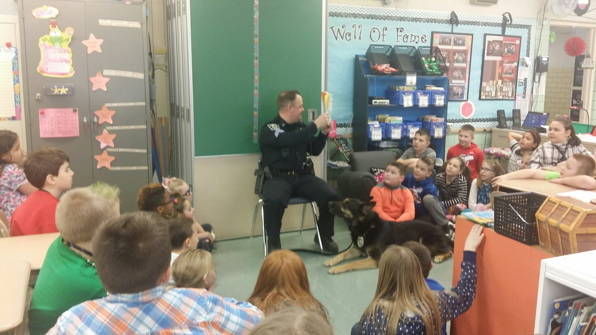 Canine Officer Brix and his partner Ryan Burnette stop by the third grade classrooms to be guest readers!