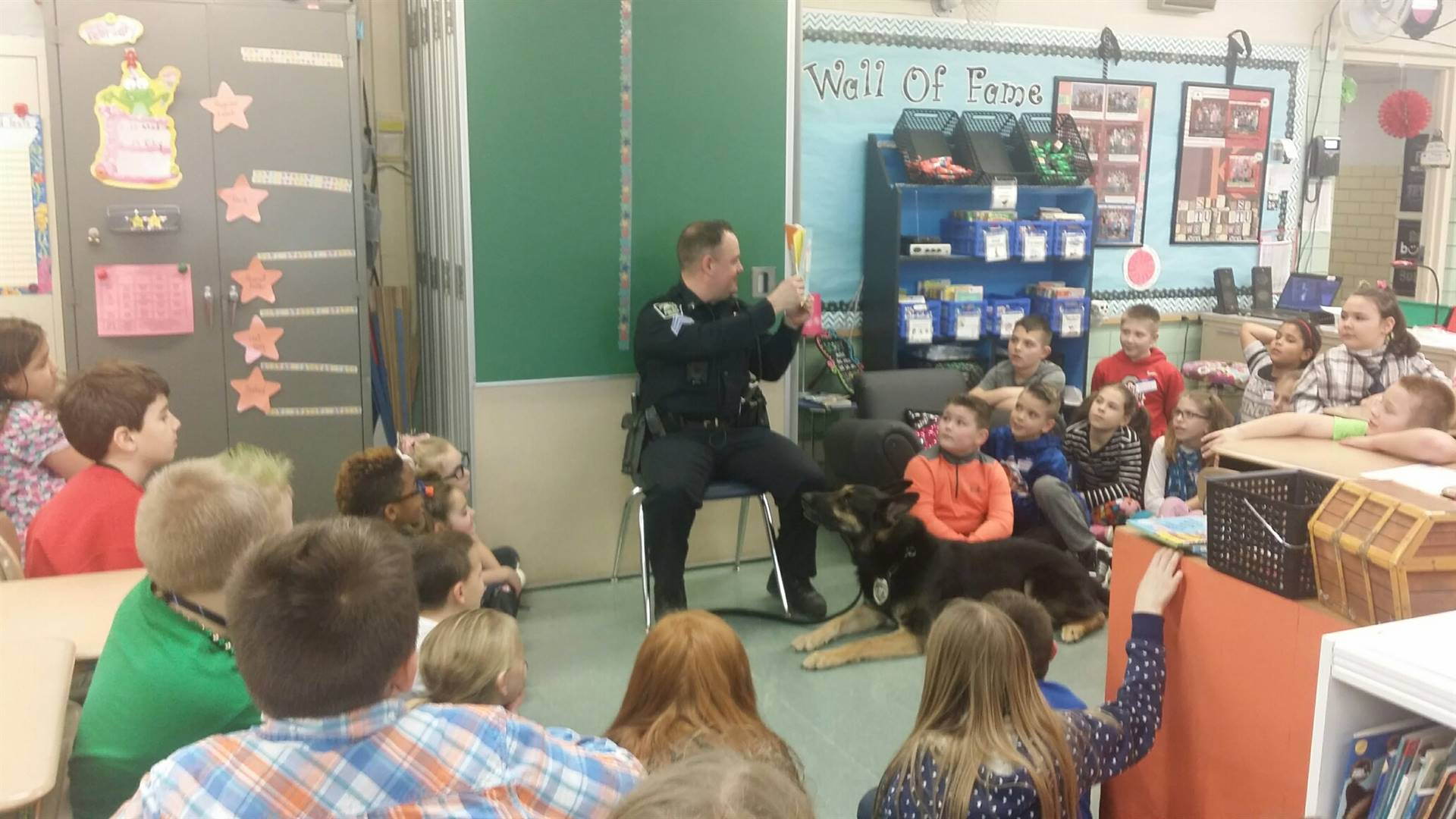 Canine Officer Brix and Officer Burnette stop by the third grade classrooms to be guest readers!