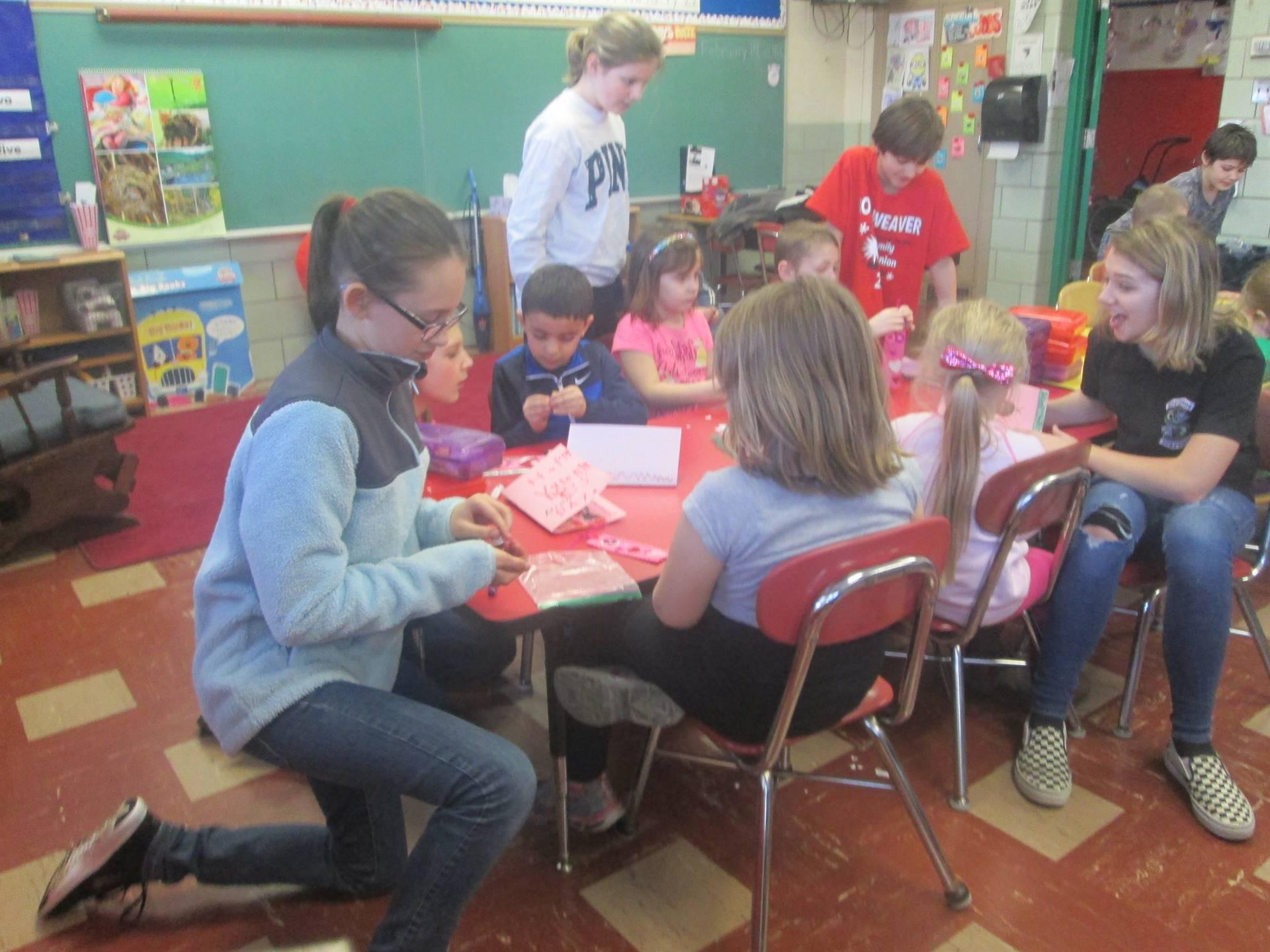 Mrs. Saiben's 6th graders assisting their kindergarten book buddies create bookmarks.