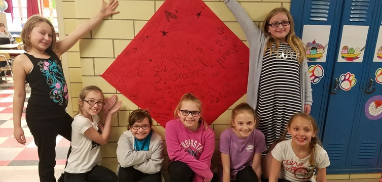 Fourth grade surprised the third grade with a poster encouraging them for their standardized tests!