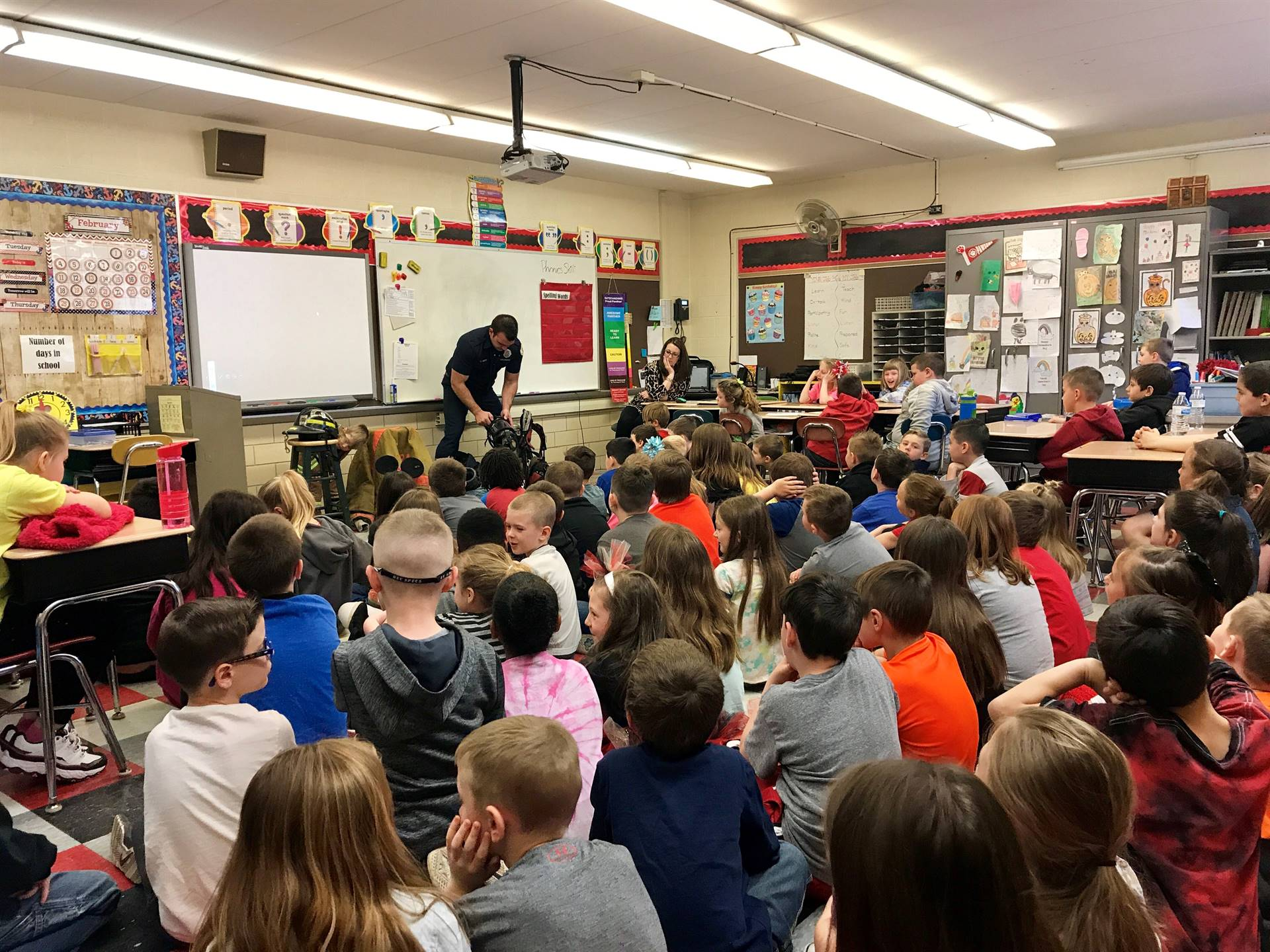 Second graders have a special visitor teach them about fire safety and the responsibilities of a fir
