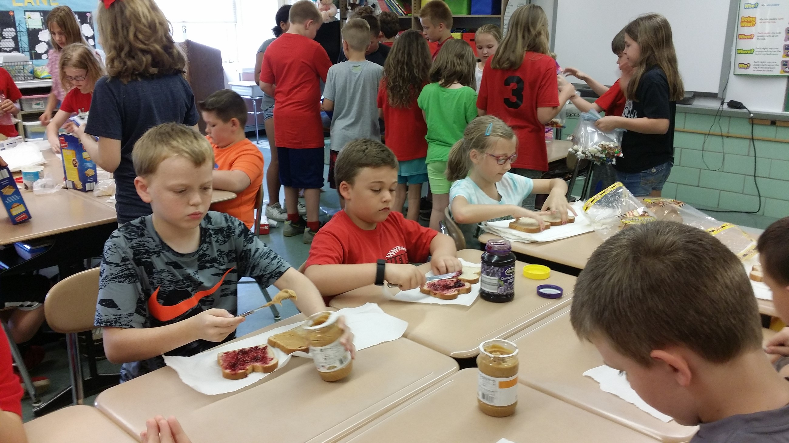 Thirds graders prepare meals for the Haven of Rest in assembly line fashion.