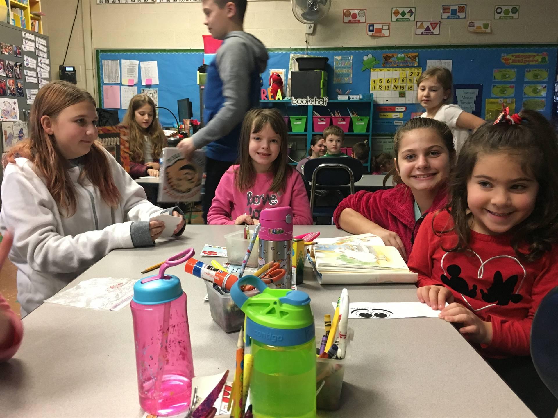 Sixth graders visited with their kindergarten reading buddies just before winter break.