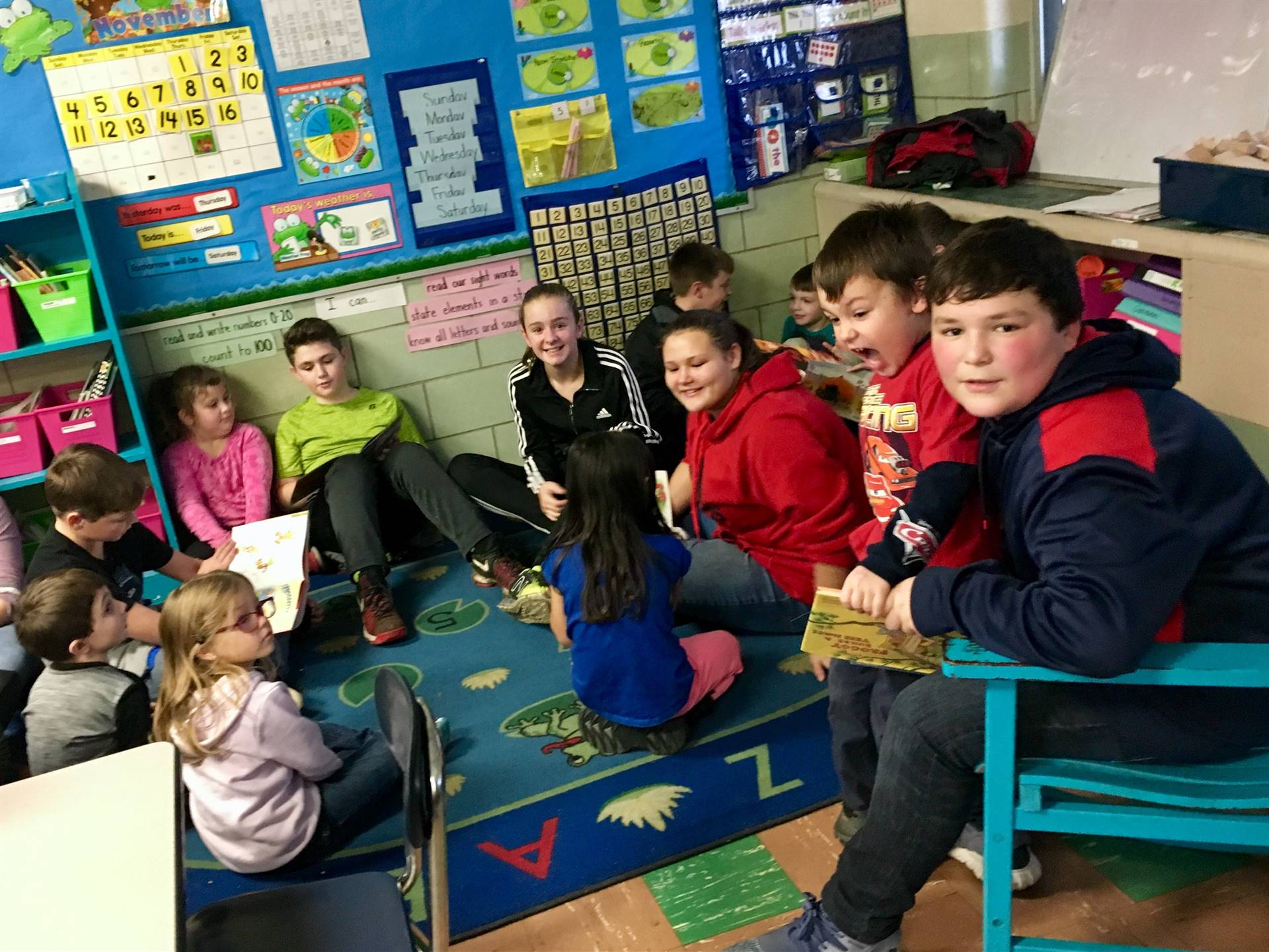 Sixth graders visited with their kindergarten reading buddies just before winter break.