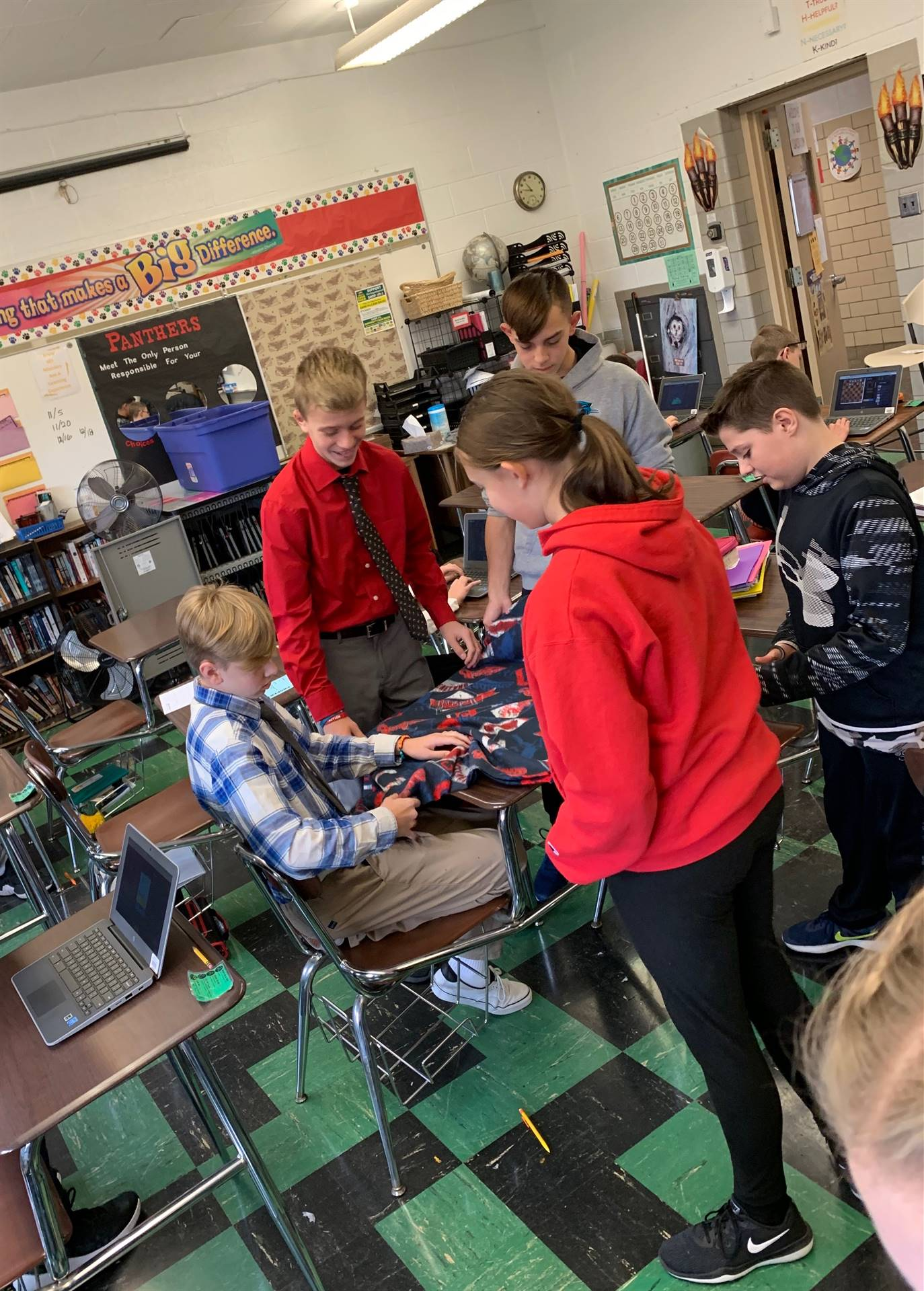 7th graders making blankets for local animal shelter.