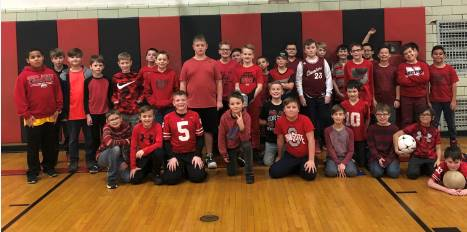 Fifth grade boys support their classmate in the recognition of Kawasaki disease awareness day