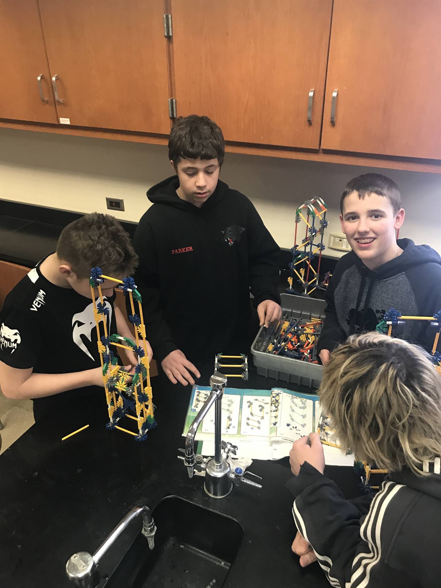 8th grade STEM students building with K'nex