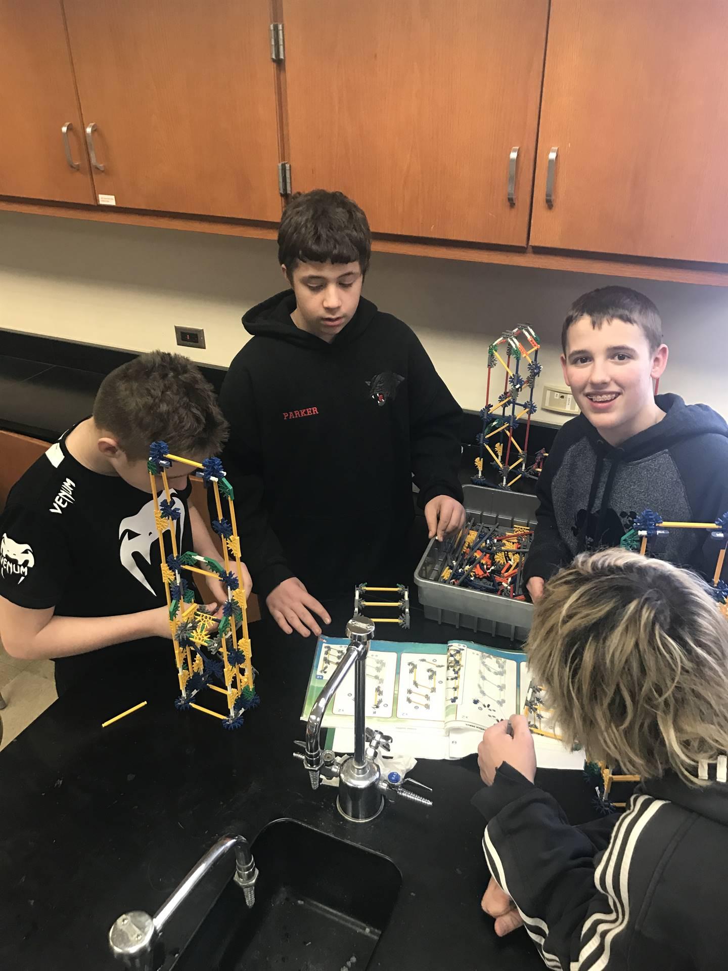 8th grade STEM students building with K'nex