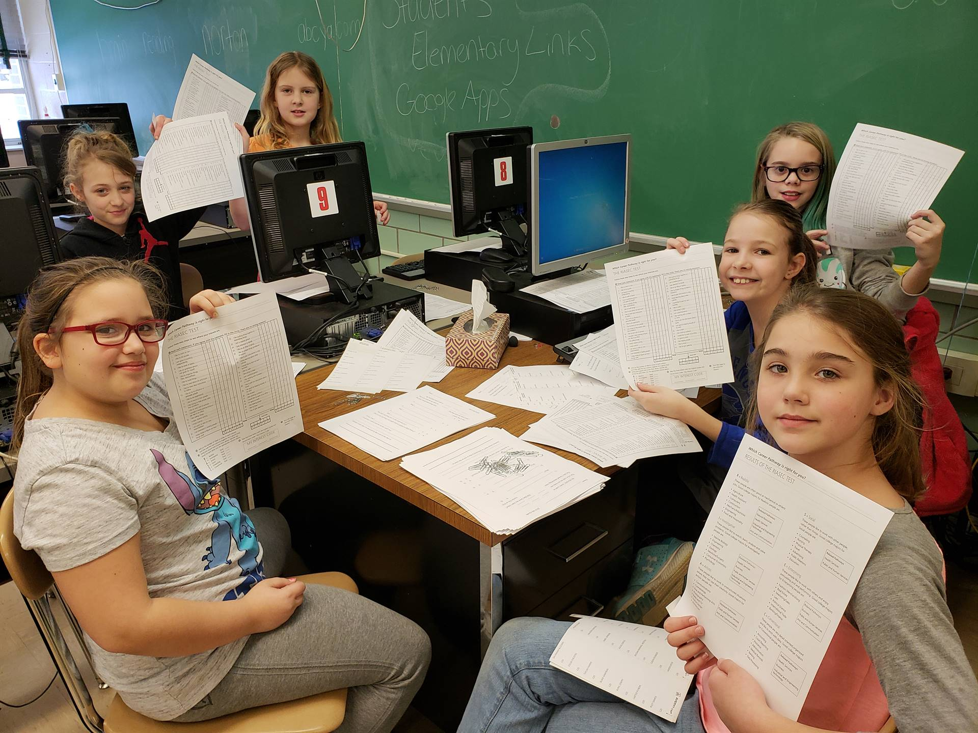 4th Grade Peer Support students helped get Interest Inventories ready.