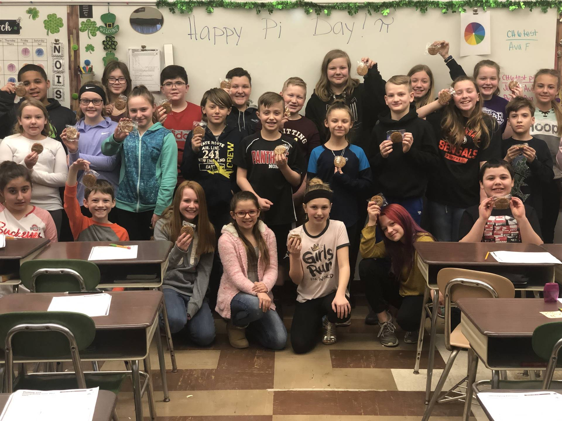 Mrs Flynn and Miss Zita's math class celebrating Pi Day with oatmeal creme pies! Happy 3.14!