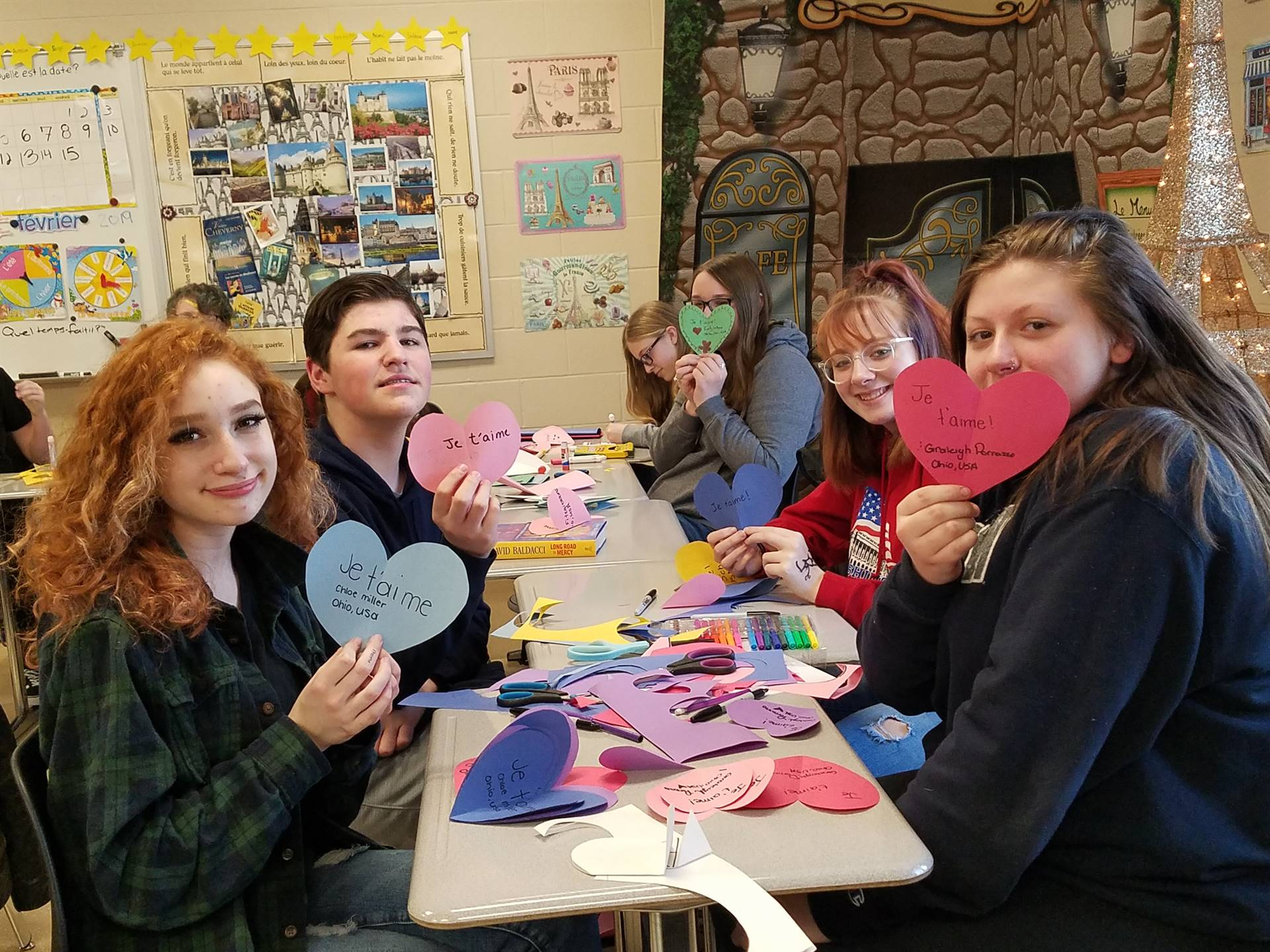 French Students Making Notes for Orphans in Haiti
