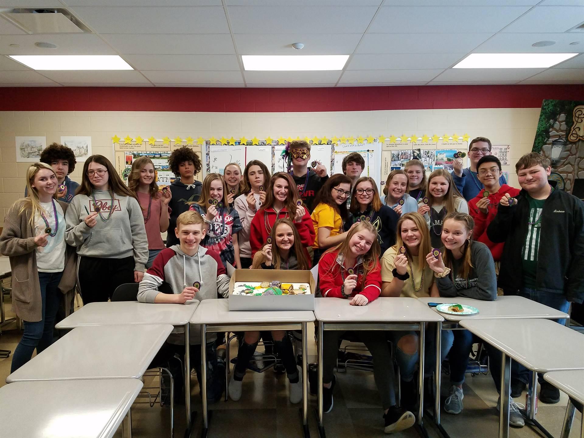 French Students Celebrating Mardi Gras with King Cake!