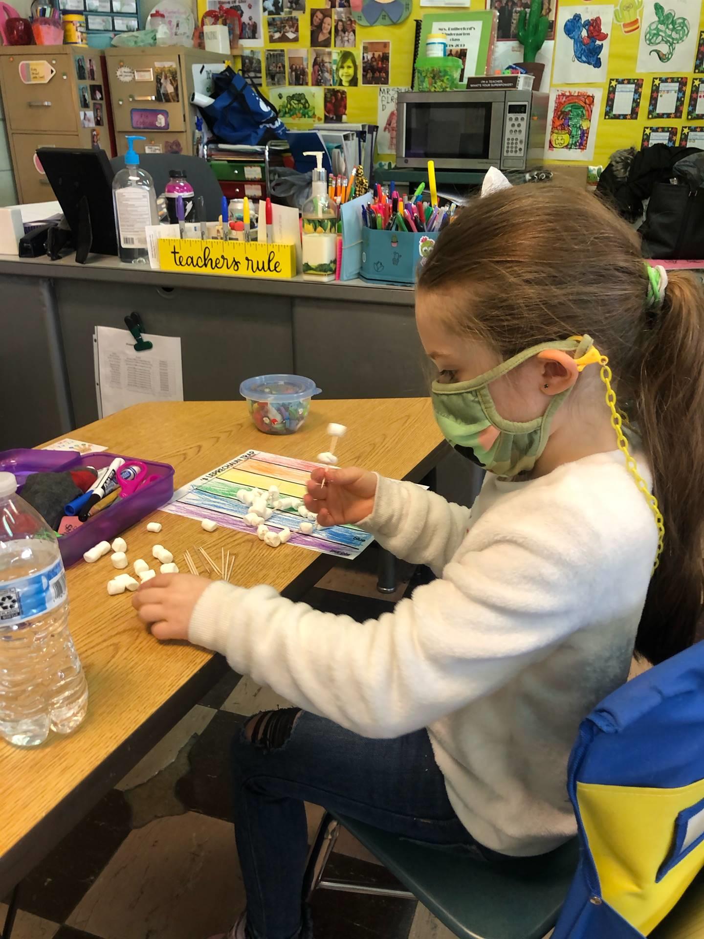 Kindergarten students are building leprechaun traps today!